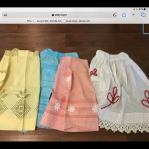 Group of 8 vintage handmade aprons
